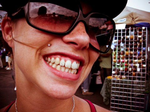 Amber's grill is blinged-out at Rock the Bells 2008