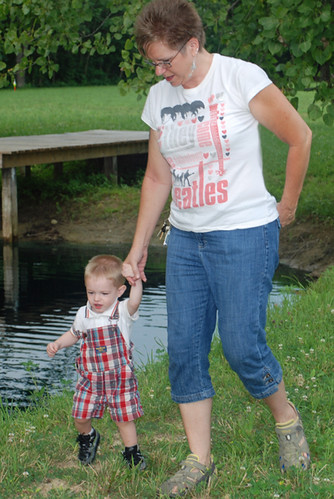 Walking & holding hands by the pond