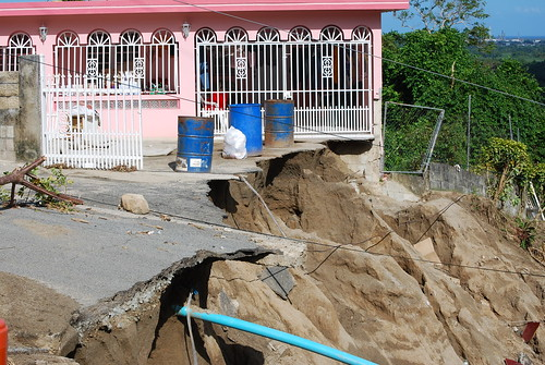 House by a collapsed road