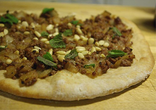 lamb pizza with pine nuts and mint