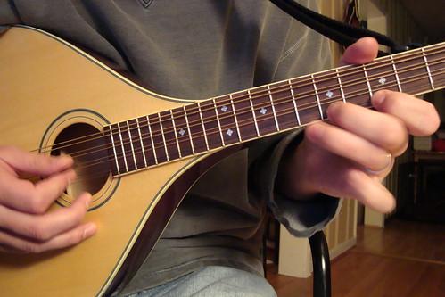 self-portrait with octave mandolin