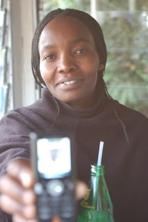 Rachel Holding a Mobile Phone - Photo : whiteafrican
