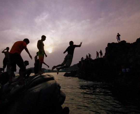 A Yemeni teenager leaps into the sea