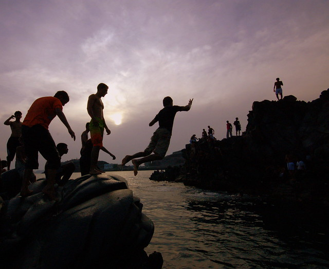 A Yemeni teenager leaps into the sea