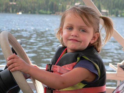 eliza drives the boat
