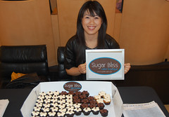 Teresa Ging displays cupcakes at It's Chic To Be Geek