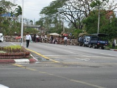 shitty shot of the roadblock in front of aung san suu kyi's home