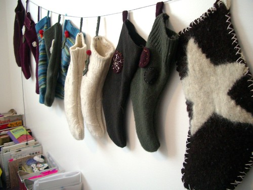 The stockings were hung from the studio wall with care.