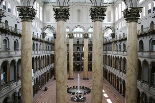 The interior of the National Building Museum.The building is the former Pension Bureau, a brick structure completed in 1887 and designed by Gen. Montgomery C. Meigs, the U.S. Army quartermaster general, which is notable for several architectural features, including the spectacular interior columns  The columns make a great place for important events like fund raisers and speeches, with the museum, relatively frequently closing for said events. Perhaps that's why Hillary Clinton choice this museum for her concession speech.