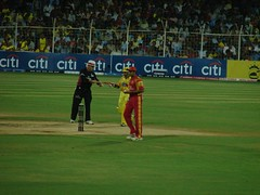 Umpire giving the bat to Parthiv Patel