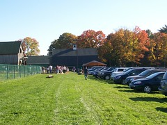Cars lined up in the big field at the stand