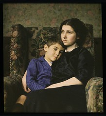 Woman and boy sitting in chair
