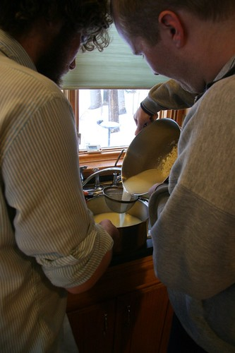 Tim and Jonathan pour off the whey before pressing the cheese.