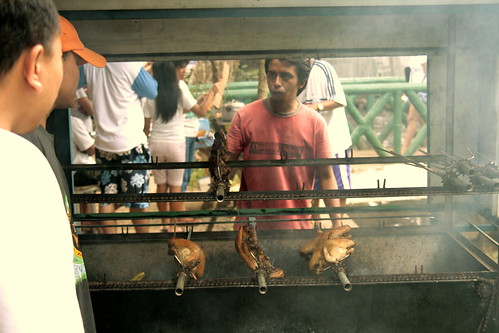 Camiguin Islnad roasting chicken on a spit, skewer  Buhay Pinoy Philippines Filipino Pilipino  people pictures photos life Philippinen
