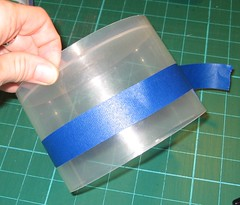 measure out tape around container