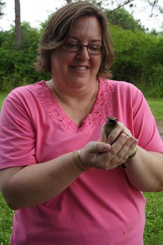 Yvonne admires a Cedar Waxwing
