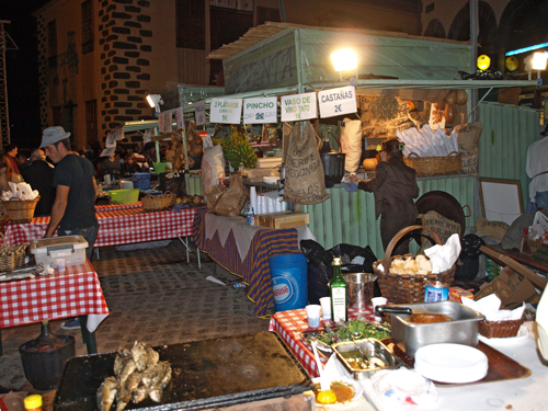 Savoury roasted chestnuts, succulent beef pinchos and sizzling sardines are just some of the flavours on offer at the street food stalls in Puerto de la Cruz on fiesta de San Andrés