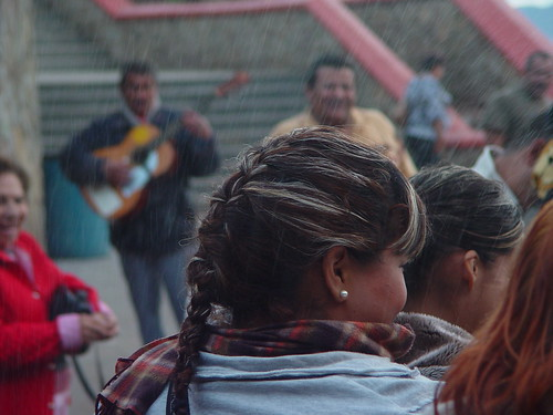 As the spray from La Bufadora rains down, a mariachi guitar player makes pretty music.