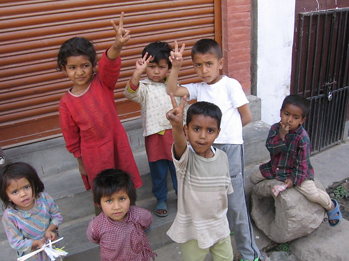 Nepal children give the peace sign
