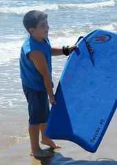 Blue boy, board, sea, day.