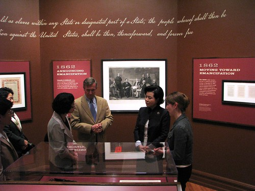 Curator Erin Mast discuss a rare copy of the Emancipation Proclamation signed by Lincoln with the First Lady of Korea Kim Yun-ok, and Director Frank Milligan.