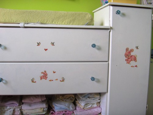 glass knobs and vintage decals on the changing table