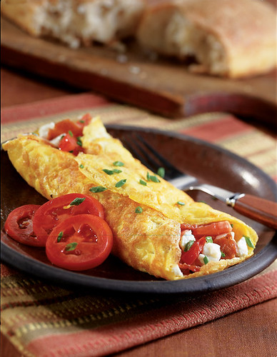 Double tomato and turkey bacon omelette