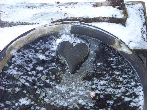 Heart detail on broken tombstone