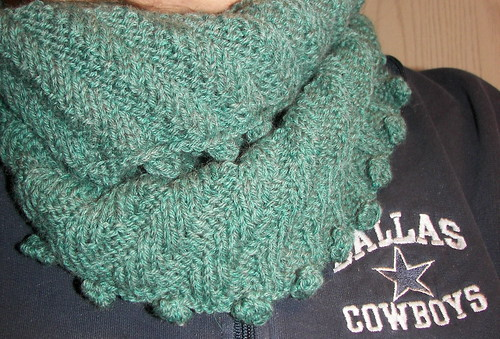 Folded down - its nicer than a scarf that could come flying off.