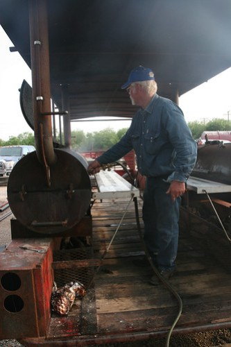 Billy fires up his mobile cooking machine to cook briskets