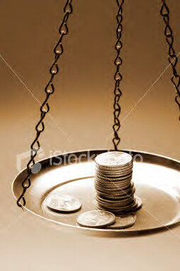 istockphoto_2161722_money_on_a_balance_scale.jpg by you.