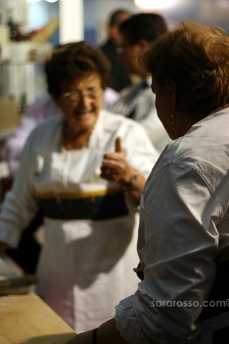 Italian woman approves of pasta-making methods at Salone del Gusto in Turin