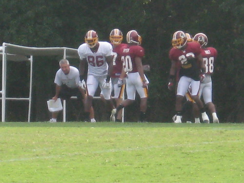 Danny Smith observes special teams practice.