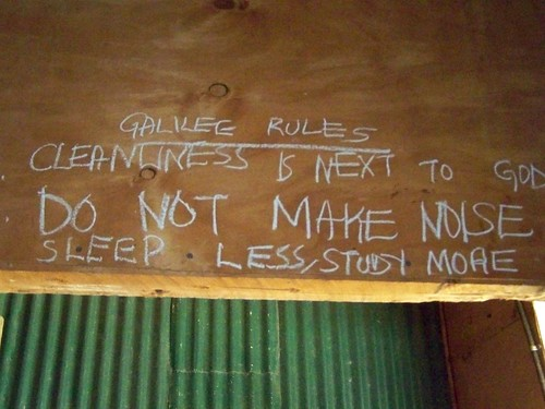 Sleep Less/Study More.... written on the wall of an Ombogo dorm wall