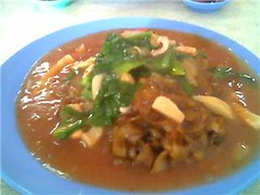 Fried kway teow in tomato sauce