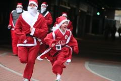 Charity Santa fun run at Manchester United's O...