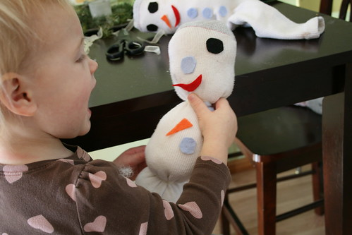 Sock-snowman playing