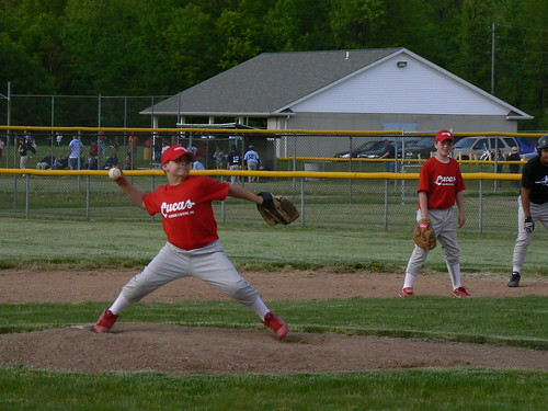 Luke Krasienko pitching, Alec Schmidt at 1st