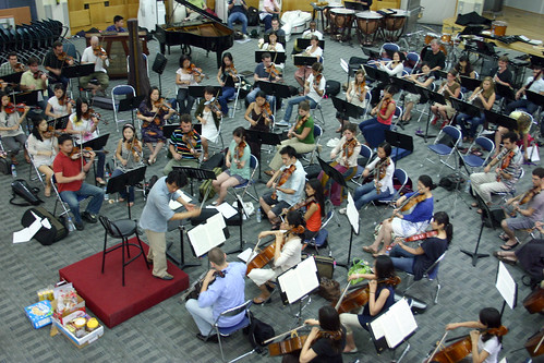Shinik Hahm leads the orchestras first rehearsal at the Kon Kuk University Convention Center.