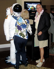 Gigi kissing the Spaceman while Papa looks dapper in his lei