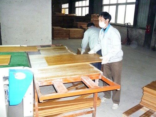 visual inspection as bamboo flooring flows off the line prior to packing.