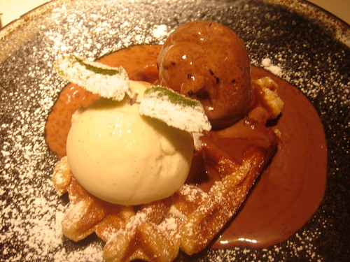 Warm waffles with hot chocolate sauce, vanilla & chocolate ice cream