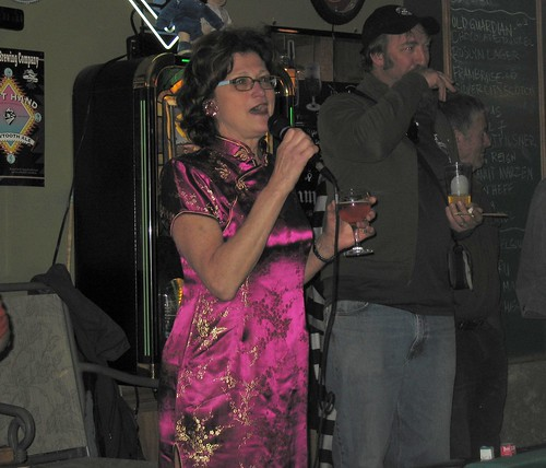 Appropriately dressed for sushi night, Carol Stoudt addressing the crowd alongside Elysian's Dave Buhler.