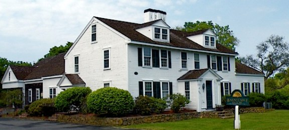 Barnstable House on Cape Cod. A white antique house dated 1716.