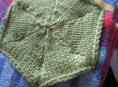 Green knitted hexagon