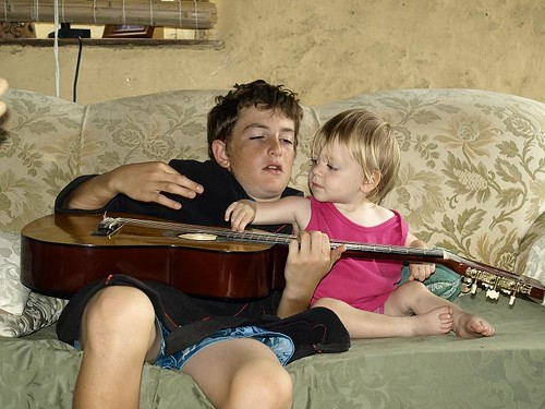 Tilly playing guitar with Uncle Nathan