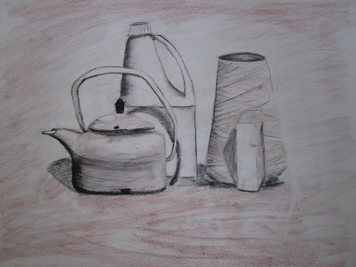 tea kettle, bottle of bleach, twine, and tin container