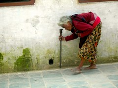 Elder Nepalese woman doing circumambulations o...