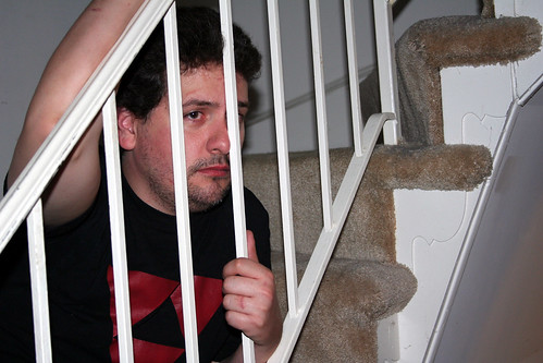 20100417 - Nicole's birthday party - 0 - Clint - dejected, behind bars - (by AE) - 4532654727_b3cd331d88_o