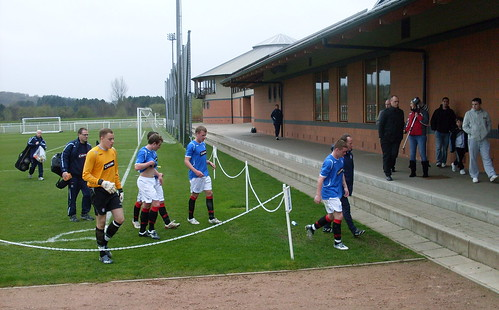 The Rangers team leave the pitch